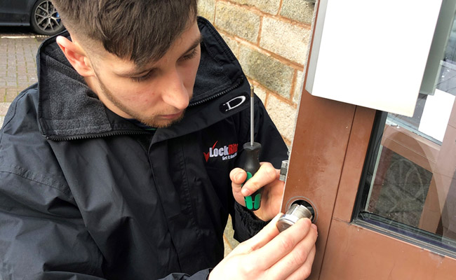 Locksmith replacing door lock