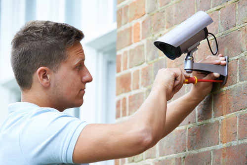 Locksmith Fitting Security Camera To Exterior Of House
